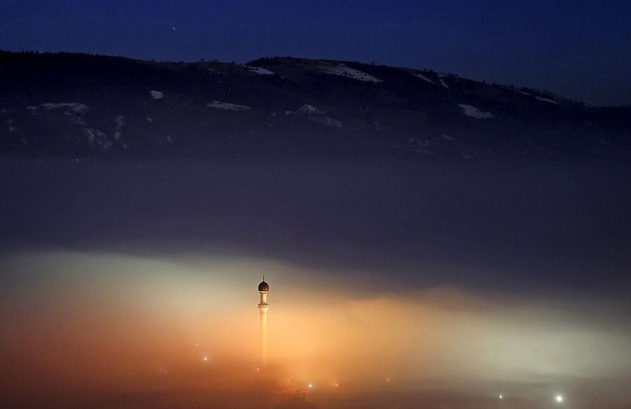 Ponijeri, Bosnia and Herzegovina A minaret rises above the smog Photograph: Dado Ruvic/Reuters